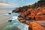Sunrise illuminates the granite cliffs at the Newport Cove Overlook along Ocean Drive/Park Loop Road in Acadia National Park, Maine, USA