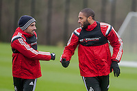 SWANSEA, WALES - JANUARY 28:  ( L-R )  Leon Britton of Swansea City and Ashley Williams chat during training  on January 28, 2015 in Swansea, Wales.