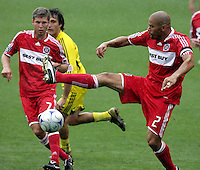Chicago Fire defender C.J. Brown (2) attempts to control the ball as teammate Logan Pause (7) looks on.  The Columbus Crew tied the Chicago Fire 2-2 at Toyota Park in Bridgeview, IL on September 20, 2009.