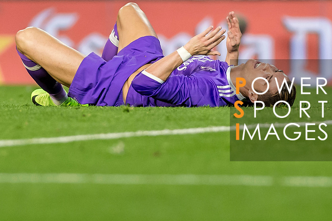 Cristiano Ronaldo of Real Madrid lies on the pitch during their La Liga match between Valencia CF and Real Madrid at the Estadio de Mestalla on 22 February 2017 in Valencia, Spain. Photo by Maria Jose Segovia Carmona / Power Sport Images