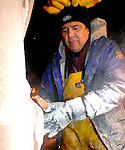 Artist Ramon Rodriguez of Dayton creates an ice sculpture on Main Street in Piqua on Friday evening as part of the annual Christmas on the Green.