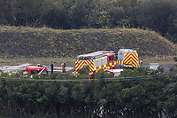 Pictured: Police and fire service personnel near by the scene in Llangennech, Wales, UK. Thursday 27 August 2020<br /> Re: A freight train carrying diesel has derailed and burst into flames in Llangennech, near Llanelli, Wales, UK.<br /> People living nearby in Carmarthenshire, were evacuated but have since returned to their homes.<br /> Police declared a major incident, put a cordon in place and closed roads.<br /> The two workers who were on board the train have been accounted for and no injuries have been reported according  to the British Transport Police.