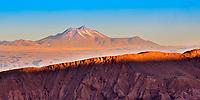 Amazing sunset light on Juriques Volcano and on the salt mountain edge, above Atacama Desert's Catarpe Valley, near San Pedro de Atacama, Chile