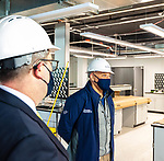 WATERBURY, CT-010721JS01- Jason Masi, Senior Vice President of Operations, right, talks about the company progress during a tour of Drew Marine in Waterbury on Thursday. The company is expected to hire 50 people on staff by the end of the year and begin chemicals production in Waterbury by the fall. Looking on is Jason Van Stone Senior Communications Manager. <br /> Jim Shannon Republican-American