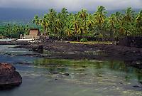 View showing Honaunau Bay, tidepools, and Hale O Keawe at Puu Honua O Honaunau National Historic Park (City of Refuge), in Kona, Hawaii.