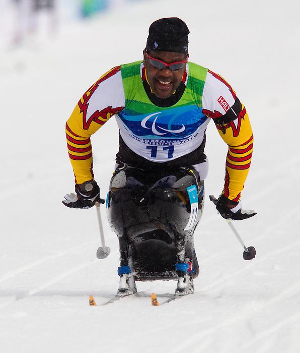 Lou Gibson, Vancouver 2010 - Para Nordic Skiing // Ski paranordique.<br /> Lou Gibson competes in Para Biathlon // Lou Gibson participe en parabiathlon. 16/03/2010.