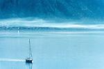 Yacht sailing through mist on bay of Kotor, Montenegro