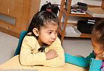 Education preschool 3 year olds girl listening to sad classmate