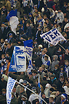 Hertha Berlin 1 Sporting Lisbon 0, 16/12/2010. Olympic Stadium, Europa League. Home fans in the Ostkurve section of the stadium waving flags before Hertha Berlin's match against  Sporting Lisbon at the Olympic Stadium in Berlin in the group stages of the UEFA Europa League. Hertha won the match by 1 goal to nil to press to the knock-out round of the cup. 2009/10 was the the first year in which the Europa League replaced the UEFA Cup in European football competition. Photo by Colin McPherson.