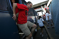 United States fans disembark a Mexican police transport bus that left Azteca Stadium under a police escort. Mexican police officers in riot gear separated the team's fan supporters to prevent any violence and fearing for the fan's safety, Mexican police transported the United States fans to a different subway stop to travel back to their hotels. The United States Men's National Team played Mexico in a CONCACAF World Cup Qualifier match at Azteca Stadium in, Mexico City, Mexico on Wednesday, August 12, 2009.