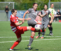 20140419 - ANTWERPEN , BELGIUM : Antwerp Charlotte Andries (left) pictured with Standard's Vanity Lewerissa (right)  during the soccer match between the women teams of RAFC Antwerp Ladies  and Standard Femina  , on the 24th matchday of the BeNeleague competition on Saturday 19 April 2014 in Deurne .  PHOTO DAVID CATRY