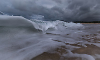 The stormy surf and overcast sky the morning before a predicted hurricane, Lanikai Beach, Windward O'ahu.