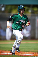 Dartmouth Big Green third baseman Justin Fowler (25) runs to first base during a game against the Eastern Michigan Eagles on February 25, 2017 at North Charlotte Regional Park in Port Charlotte, Florida.  Dartmouth defeated Eastern Michigan 8-4.  (Mike Janes/Four Seam Images)