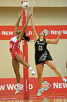 England goalkeep Eboni Beckford-Chambers defends a pass to Catherine Latu during the New World Quad Series international Netball match between New Zealand Silver Ferns and England at TSB Bank Arena, Wellington, New Zealand on Thursday, 25 October 2012. Photo: Dave Lintott / lintottphoto.co.nz