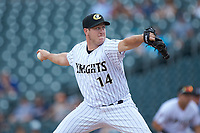 Charlotte Knights relief pitcher Rob Scahill (14) in action against the Indianapolis Indians at BB&T BallPark on August 22, 2018 in Charlotte, North Carolina.  The Indians defeated the Knights 6-4 in 11 innings.  (Brian Westerholt/Four Seam Images)