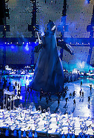 """27 JUL 2012 - LONDON, GBR - A giant puppet of Lord Voldemort from the Harry Potter series of books walks past childrens beds as part of a sequence celebrating  British children's literature during the """"Second To The Right, And Straight On Till Morning"""" section of the Opening Ceremony of the London 2012 Olympic Games in the Olympic Stadium in the Olympic Park, Stratford, London, Great Britain .(PHOTO (C) 2012 NIGEL FARROW)"""