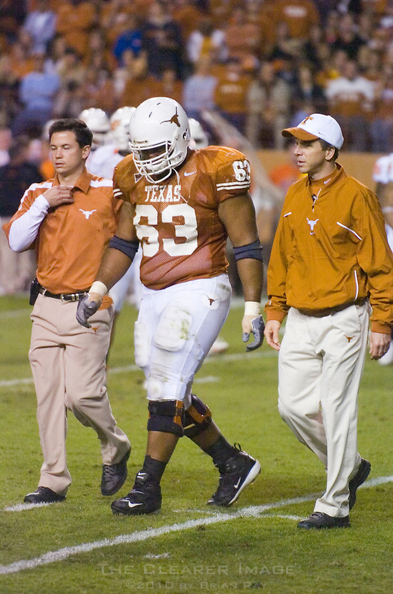 04 November 2006: Texas lineman Justin Blalock (#63) is led off the field by trainers after a minor injury during the Longhorns 36-10 victory over the Oklahoma State University Cowboys at Darrel K Royal Memorial Stadium in Austin, Texas.