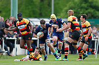 Lewis Wynne of London Scottish fends off Adams of Richmond Rugby during the Greene King IPA Championship match between London Scottish Football Club and Richmond at Richmond Athletic Ground, Richmond, United Kingdom on 27 April 2019. Photo by Carlton Myrie.