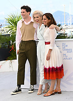 CANNES, FRANCE. July 10, 2021: Josh O'Connor, Eva Husson & Elizabeth Karlsen at the photocall for Mothering Sunday at the 74th Festival de Cannes.<br /> Picture: Paul Smith / Featureflash