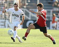 Michael Nanchoff #9 of the University of Akron boots the ball away from Charlie Campbell #2 of the University of Louisville during the 2010 College Cup final at Harder Stadium, on December 12 2010, in Santa Barbara, California.Akron champions, 1-0.