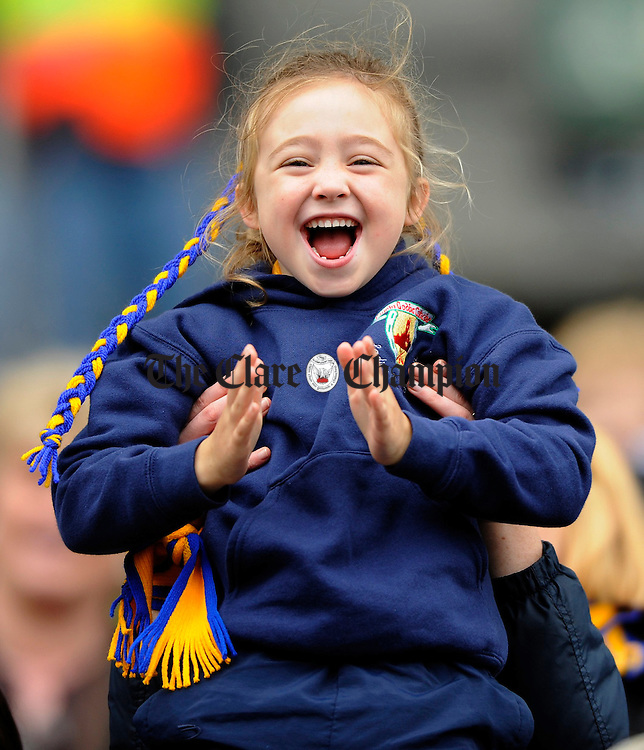 A young happy Clare face in the crowd as Shonagh Enright scores the winning goal during the All-Ireland junior camogie final at Croke Park. Photograph by John Kelly.