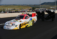 Jul. 19, 2014; Morrison, CO, USA; NHRA funny car driver Cruz Pedregon during qualifying for the Mile High Nationals at Bandimere Speedway. Mandatory Credit: Mark J. Rebilas-