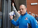 Craig Houston from fans group Sons of Struth posts his demonstration card through the locked doors of Ibrox Stadium this afternoon