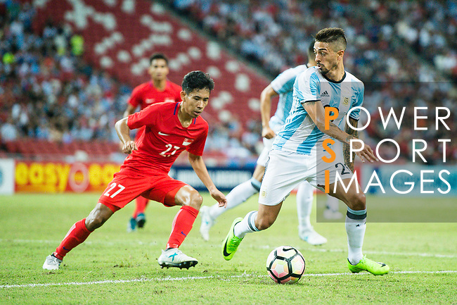 Manuel Lanzini of Argentina (R) fights for the ball with Nazrul Nazari of Singapore (L) during the International Test match between Argentina and Singapore at National Stadium on June 13, 2017 in Singapore. Photo by Marcio Rodrigo Machado / Power Sport Images