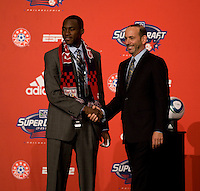 MLS commissioner Don Garber welcomes Tony Tchani of the University of Virginia to the stage as the second overall pick of  the MLS Superdraft by the New York Red Bulls at the Pennsylvania Convention Center in Philadelphia, PA.