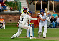 21st September 2021; Aigburth, Merseyside, England; County Championship Cricket, Lancashire versus Hampshire, Day 1; Brad Wheal of Hampshire drives the ball past Dane Vilasof Lancashire as Hampshire struggle to get their score near 150