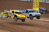 Mar. 20, 2011; Chandler, AZ, USA;  LOORRS pro four driver Aaron Daughterty (24) and Travis Coyne side by side off the jump during round two at Firebird International Raceway. Mandatory Credit: Mark J. Rebilas-