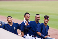 Leugim Castillo (57), Pablo Abreu (2), Jean Carmona (5), and Yeison Coca (7) of the AZL Brewers pose for a photo during a game against the AZL Padres 2 on September 2, 2017 at Maryvale Baseball Park in Phoenix, Arizona. AZL Brewers defeated the AZL Padres 2 2-0. (Zachary Lucy/Four Seam Images)