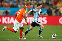 Lionel Messi of Argentina and Nigel de Jong of the Netherlands