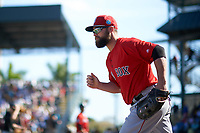 Boston Red Sox right fielder Bryce Brentz (64) takes the field during a Spring Training game against the Pittsburgh Pirates on March 9, 2016 at McKechnie Field in Bradenton, Florida.  Boston defeated Pittsburgh 6-2.  (Mike Janes/Four Seam Images)