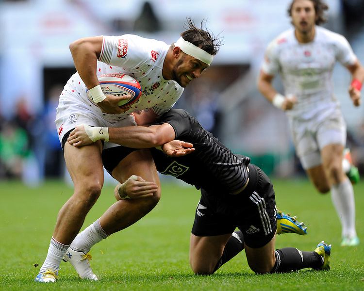 Chris Cracknell of England is tackled by Bryce Heem of New Zealand during Day One of the iRB Marriott London Sevens at Twickenham on Saturday 10th May 2014 (Photo by Rob Munro)