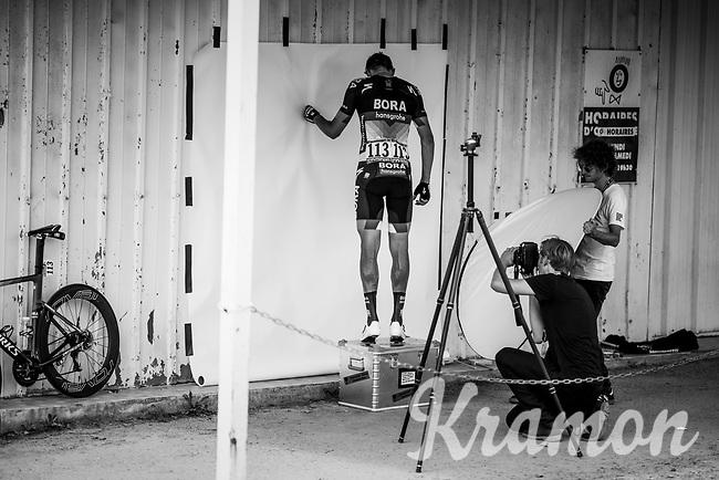photographer Timm Kölln at work with Marcus Burghardt (DEU/BORA-hansgrohe) (shooting his calves) afer the stage<br /> <br /> Stage 1: Noirmoutier-en-l'Île > Fontenay-le-Comte (189km)<br /> <br /> Le Grand Départ 2018<br /> 105th Tour de France 2018<br /> ©kramon