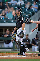 Charlotte Knights catcher Kevan Smith (32) on defense against the Norfolk Tides at BB&T BallPark on April 20, 2016 in Charlotte, North Carolina.  The Knights defeated the Tides 6-3.  (Brian Westerholt/Four Seam Images)