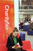 A visitor reads literature on sale at the annual Charity Fair organised by the Directory of Social Change.