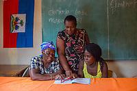 Haiti, Gros-Morne. Mercy Beyond Borders projects. Women in literacy class.