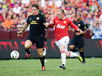 Wayne Rooney (10) of Manchester United has the ball cleared away from him by Andreu Fontas (24) of Barcelona during the friendly at FedEX Field in Landover, MD.  Manchester United defeated FC Barcelona, 2-1.