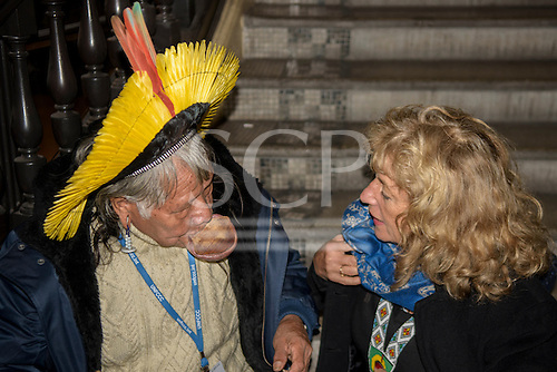 Paris, December 2015. United Nations Climate Change Conference - COP 21. United Nations Development Programme (UNDP) Equator Prize ceremony at the Theatre Mogador. Sue Cunningham talks to Chief Raoni Metuktire on the steps of the theatre.