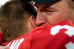 Head coach Bret Bielema embraces defensive back Ben Strickland following the Badger win over Arkansas.<br />