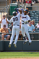Somerset Patriots Dermis Garcia (20) celebrates with Isiah Gilliam (24) after hitting a home run during a game against the Hartford Yard Goats on September 12, 2021 at TD Bank Ballpark in Bridgewater, New Jersey.  (Mike Janes/Four Seam Images)