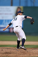 Spencer Herrmann (56) of the Everett AquaSox pitches during a game against the Spokane Indians at Everett Memorial Stadium on July 24, 2015 in Everett, Washington. Everett defeated Spokane, 8-6. (Larry Goren/Four Seam Images)
