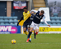 20th February 2021; Dens Park, Dundee, Scotland; Scottish Championship Football, Dundee FC versus Queen of the South; Isaiah Jones of Queen of the South challenges for the ball with Paul McMullan of Dundee