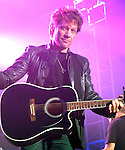 John Bon Jovi provided the entertainment at the Lanier Law Firm's Holiday Bash Sunday Dec. 13,2009.(Dave Rossman/For the Chronicle)