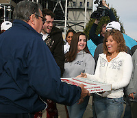 "State College, PA -- 10/25/2007 -- Penn State freshman Maddy Hoover (right), a biology major from Spring Grove, PA, accepts a pizza from football coach Joe Paterno, while her friends Sean Burdette, also from Spring Grove, and Shannon Hitchcock, from Elmira, NY, watch.  Penn State students camp outside of Beaver Stadium in hopes to be near the front of the student section for the game against Ohio State this Saturday.  The gathering of tents outside of the student entrance to the stadium has been dubbed ""Paternoville"" and received a visit from its namesake, Joe Paterno, and his wife, Sue, this morning.  The Paterno's delivered pizza to the students and thanked them for their support of the football team...Photo:  Joe Rokita / JoeRokita.com"