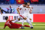 Yousef Rawshdeh of Jordan (top) fights for the ball with Nguyen Huy Hung of Vietnam (bottom) during the AFC Asian Cup UAE 2019 Round of 16 match between Jordan (JOR) and Vietnam (VIE) at Al Maktoum Stadium on 20 January 2019 in Dubai, United Arab Emirates. Photo by Marcio Rodrigo Machado / Power Sport Images