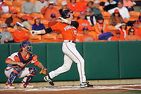 Virginia Cavaliers left fielder Derek Fisher #23 swings at a pitch during a game against the Clemson Tigers at Doug Kingsmore Stadium on March 15, 2013 in Clemson, South Carolina. The Cavaliers won 6-5.(Tony Farlow/Four Seam Images).