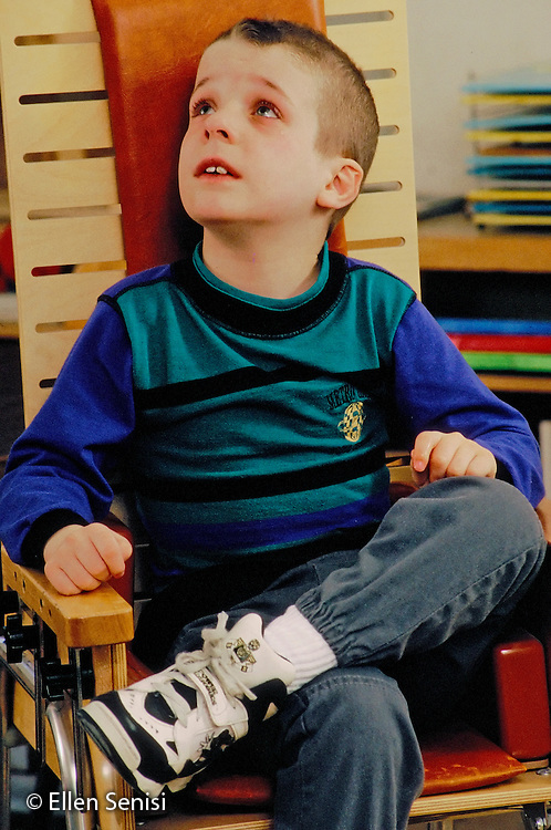 MR / Schenectady, NY.Yates Arts Magnet School / Special Education Class.Boy (7, autistic, ADHD) cries; is sitting in special chair where he can be restrained if he loses self-control..MR: Cou3.PN#:15823                        FC#:21603-00108.scan from slide.©Ellen B. Senisi
